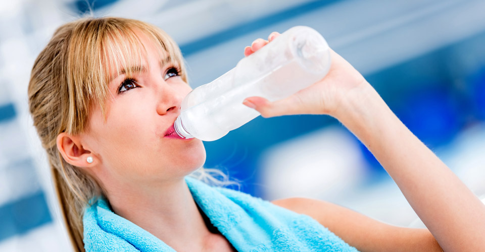 girl drinking water at gym